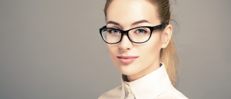 blond female wearing glasses