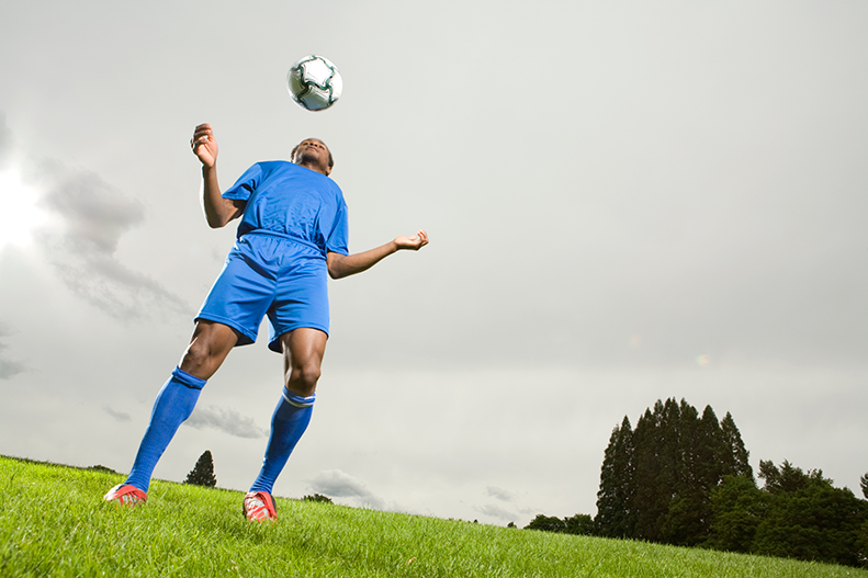 soccer player headbutting soccer ball