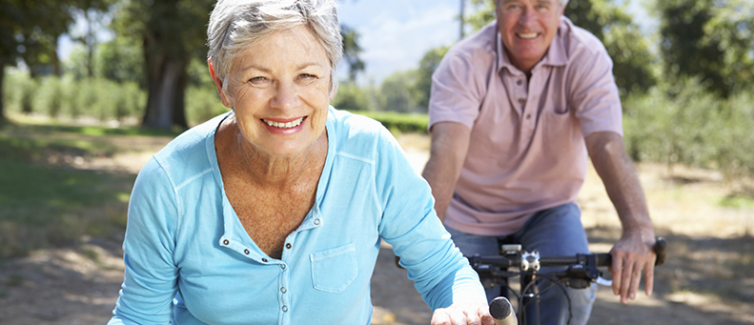elderly couple biking