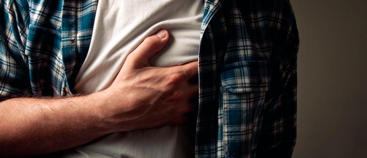 man grabbing chest