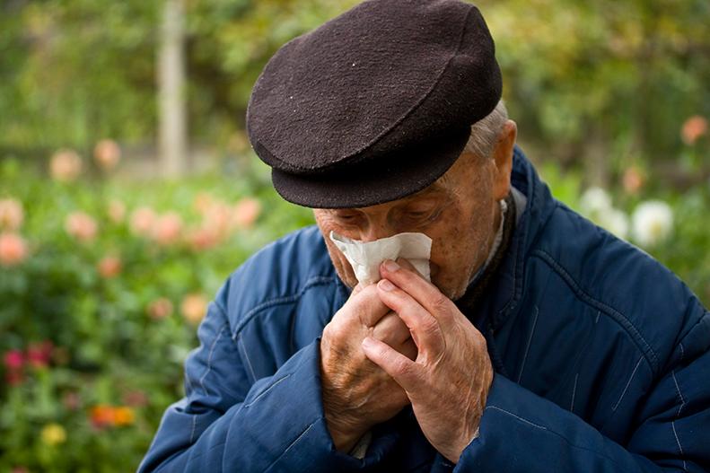 elderly man coughing