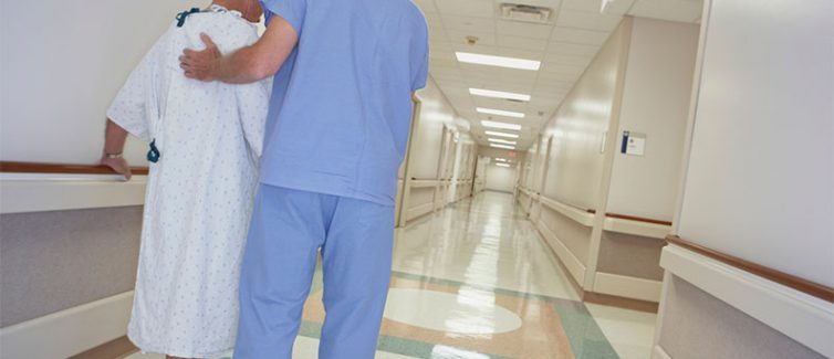 patient walking through hospital