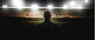 Night game with athlete in silhouette