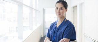 Female physician in scrubs
