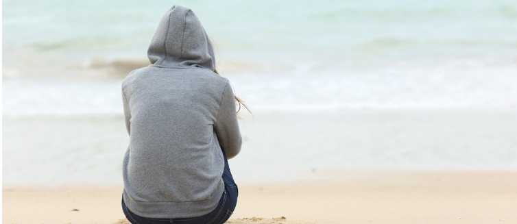 Person contemplating life at the beach