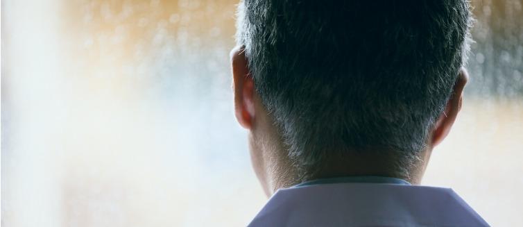 Man thinking gazing out window