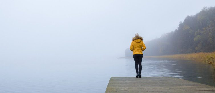 Woman on dock looking out at water