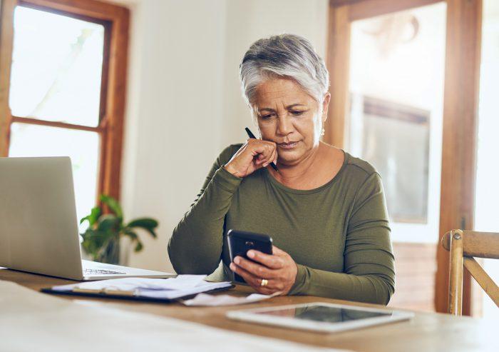 Older woman looking at phone