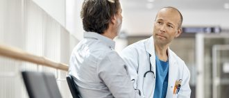 Doctor Counseling Male Patient